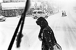 People cross a road in a heavy snow in Otaru.