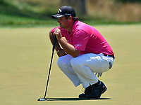 Potomac, MD - June 30, 2017: Patrick Reed studies the 9th green before his putt during Round 2 of professional play at the Quicken Loans National Tournament at TPC Potomac at Avenel Farm in Potomac, MD, June 30, 2017.  (Photo by Don Baxter/Media Images International)