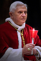 Pope Benedict XVI waves at the end of a Mass celebrated by Cardinal Camillo Ruini, head of Italian Bishops Board, not seen, for the 'World Day of the Sick' in St. Peter's Basilica at the Vatican, Sunday, Feb. 11, 2007..