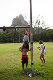 FRENCH POLYNESIA, Moorea. Girls playing at the Uop Honu Park in Moorea Island.
