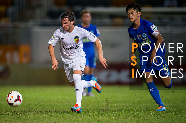 (L) Pablo Piatti of Valencia CF followed by (R) Ming Kong Chan of BC Rangers FC during LFP World Challenge 2014 between Valencia CF vs BC Rangers FC on May 28, 2014 at the Mongkok Stadium in Hong Kong, China. Photo by Victor Fraile / Power Sport Images
