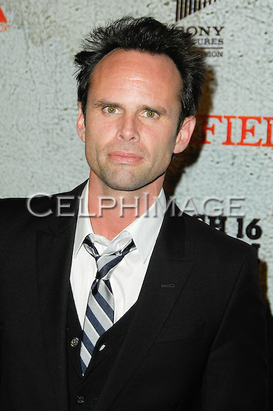 WALTON GOGGINS. Arrivals to the premiere screening of the FX original drama series, Justified, at the Directors Guild of America. Los Angeles, CA, USA. March 8, 2010.