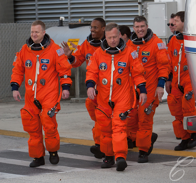 Discovery astrouants prepare to leave for the launch pad February 24, 2011.   From Left: Pilot Eric Boe, Mission Specialist Alvin Drew, Commander Steve Lindsey, Mission Specialist Steve Bowen and Mission Specialist Michael Barrat.  Mission Specialist Nicole Stott is in the background.