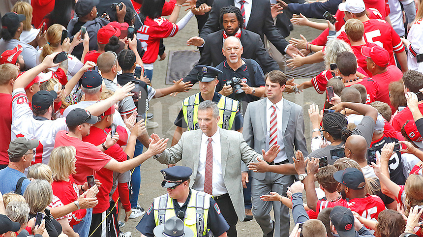 Ohio State University head coach Urban Meyers high fives fans on the team's procession into Ohio Stadium on September 26, 2015. (Chris Russell/Dispatch Photo)