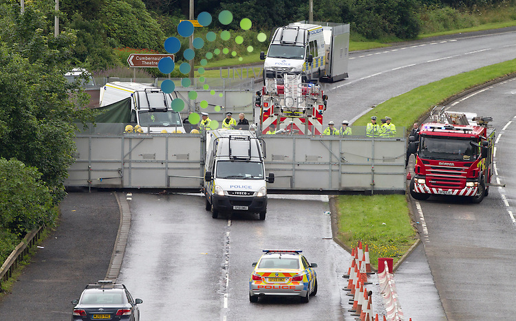 Three men have died and another man has been injured in a car crash in Cumbernauld, North Lanarkshire. The accident, involving three cars, happened at about 12:45 on the A8011 Central Way dual carriageway, known locally as Wilderness Brae. Three men died at the scene and the injured man has been taken to Monklands Hospital in Airdrie. <br />