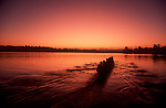 Women's eight-oared racing shell rowing at dawn, Seattle, Lake Washington,