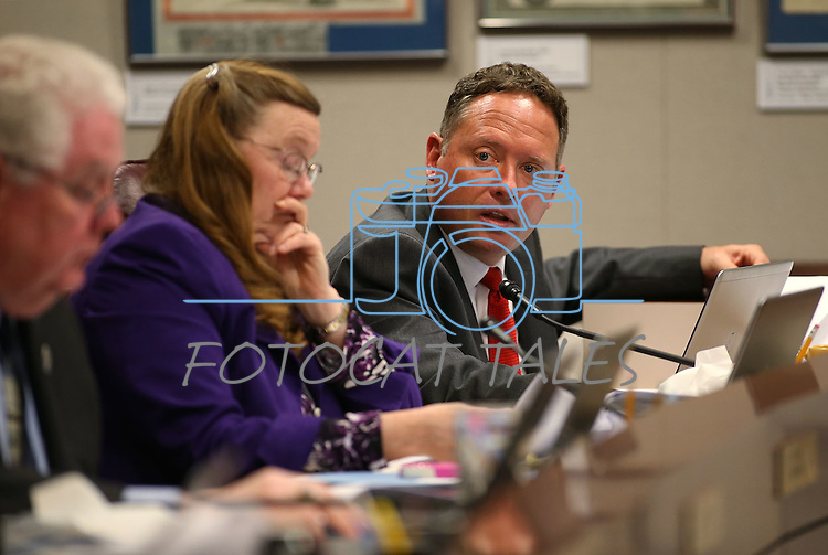 Nevada Assembly members, from left, Speaker John Hambrick, R-Las Vegas, Maggie Carlton, D-Las Vegas, and Mike Sprinkle, D-Sparks, work in committee at the Legislative Building in Carson City, Nev., on Tuesday, May 5, 2015.<br /> Photo by Cathleen Allison