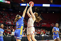 College Park, MD - March 25, 2019: UCLA Bruins guard Lindsey Corsaro (4) tries to block Maryland Terrapins guard Taylor Mikesell (11) shot during game between UCLA and Maryland at  Xfinity Center in College Park, MD.  (Photo by Elliott Brown/Media Images International)