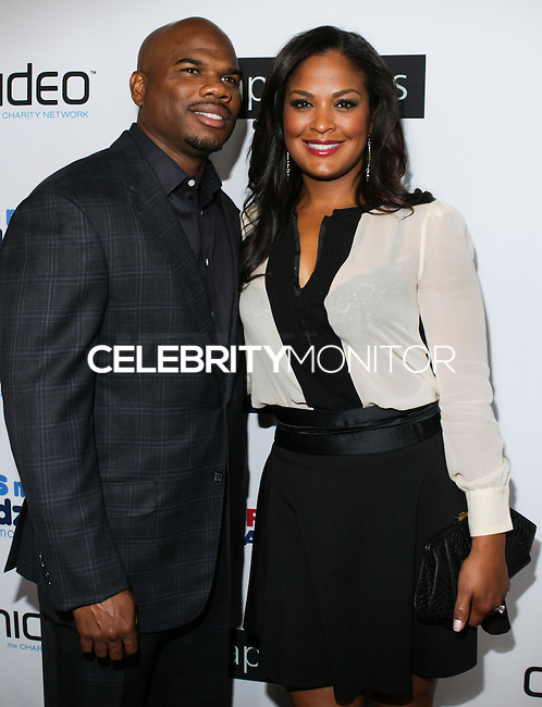 BEVERLY HILLS, CA, USA - OCTOBER 26: Curtis Conway, Laila Ali arrive at the CP3 Foundation Celebrity Server Dinner held at Mastro's Steakhouse on October 26, 2014 in Beverly Hills, California, United States. (Photo by Rudy Torres/Celebrity Monitor)
