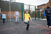 Children from a Westminster Sports programme play football on a new outdoor pitch at Jubilee Sports Centre