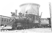 3/4 fireman's-side view of C-19 #344 with plow.  Water tank in background.<br /> D&amp;RGW  Gunnison ?, CO