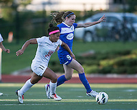 In a National Women's Soccer League Elite (NWSL) match, the Boston Breakers defeated the FC Kansas City, 1-0, at Dilboy Stadium on August 10, 2013.  FC Kansas City midfielder Desiree Scott (11) and Boston Breakers midfielder Heather O'Reilly (9) compete for the ball.