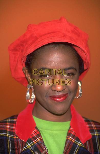 DIANE LOUISE JORDAN.Ref: 026.headshot, portrait, red hat, gold hoop earrings.www.capitalpictures.com.sales@capitalpictures.com.©Capital Pictures