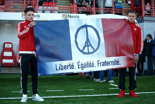 Hamilton youth players with a French banner