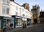 Shops in Market Place with Penniless Porch and the cathedral, Wells, Somerset, England