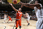 28 February 2016: Wake Forest's Bryant Crawford (right) inbounds the ball over Virginia Tech's Justin Robinson (5) towards Wake Forest's Doral Moore (4). The Wake Forest University Demon Deacons hosted the Virginia Tech Hokies at Lawrence Joel Veterans Memorial Coliseum in Winston-Salem, North Carolina in a 2015-16 NCAA Division I Men's Basketball game. Virginia Tech won the game 81-74.