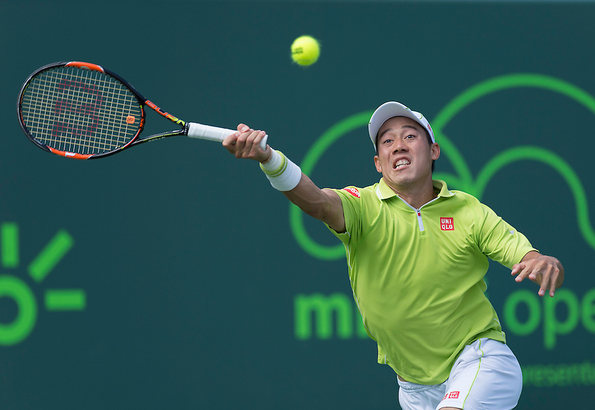 KEY BISCAYNE, FL - April 02: Kei Nishikori (JPN)in action here loses 64 63 to John Isner (USA) at the 2015 Miami Open at the Crandon Tennis Center in Key Biscayne Florida.   Photographer Andrew Patron - CameraSport/BigShots<br /> <br /> Tennis - 2015 Miami Open presented by Itau - Crandon Park Tennis Center - Key Biscayne, Florida - USA - Day 11, Thursday 2nd April 2015<br /> <br /> &copy; CameraSport - 43 Linden Ave. Countesthorpe. Leicester. England. LE8 5PG - Tel: +44 (0) 116 277 4147 - admin@camerasport.com - www.camerasport.com