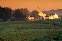 Farm buildings and field at sunrise. Strasburg Pennsylvania USA Lancaster County.