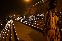 Candle light with holy, purified butter at the stairways (ghats) of river Ganges in Varanasi, India Sacred rituals with light and fire go back to ancient times in India. God of fire (Agni) and Surya (Sun) belong to the oldest gods in India, going back to Vedic times, in which Shiva or Brahman still were unknown.