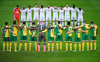 Swansea City and Norwich City players stand for a minutes silence for Remembrance Day during the Barclays Premier League match between Norwich City and Swansea City played at Carrow Road, Norwich on November 6th 2015