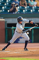 Jake Hager (2) of the Montgomery Biscuits lays down a bunt against the Chattanooga Lookouts at AT&T Field on July 24, 2014 in Chattanooga, Tennessee.  The Biscuits defeated the Lookouts 6-4. (Brian Westerholt/Four Seam Images)