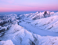Alpen Glow of the Alaska Range following sunset from 12,000 ft. arial photograph;   Denali National Park, Alaska, USA