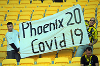 Fans with a Covid-19 banner during the A-League football match between Wellington Phoenix and Melbourne Victory FC at Sky Stadium in Wellington, New Zealand on Sunday, 15 March 2020. Photo: Dave Lintott / lintottphoto.co.nz