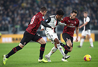 Calcio, Serie A: Juventus - Milan, Turin, Allianz Stadium, November 10, 2019.<br /> Juventus' Juan Cuadrado (c) in action with Milan's Rade Krunic (l) and Hakan  Calhanoglu (r) during the Italian Serie A football match between Juventus and Milan at the Allianz stadium in Turin, November 10, 2019.<br /> UPDATE IMAGES PRESS/Isabella Bonotto