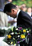 Japanese Prime Minister Taro Aso lays flowers at the National Cemetery in Tokyo on Saturday 15 Aug. 2009.  Aug. 15 marks the 64th anniversary of Japan's surrender in the Pacific War.