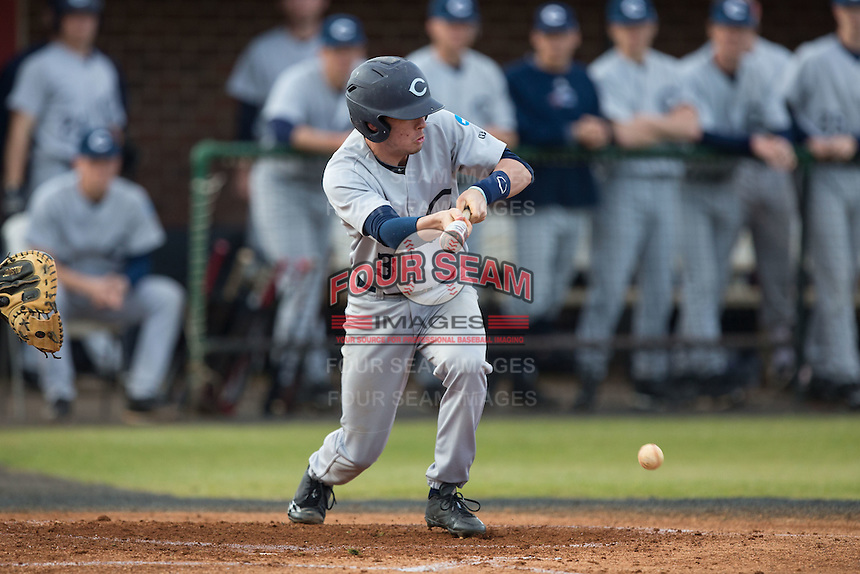 Jeremy Simpson (3) of the Catawba Indians lays down a bunt against the Belmont Abbey Crusaders at Abbey Yard on February 7, 2017 in Belmont, North Carolina.  The Crusaders defeated the Indians 12-9.  (Brian Westerholt/Four Seam Images)