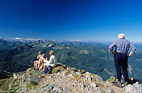 Austria, Styria, Reiteralm Panorama Trail: hikers at peak of Rippeteck mountain (2.126m)