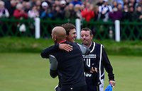 Thorbjorn Olesen of Denmark is congratulated by Surfer Kelly Slater (L)  on the 18th green during the Final Round of the 2015 Alfred Dunhill Links Championship at the Old Course, St Andrews, in Fife, Scotland on 4/10/15.<br /> Picture: Richard Martin-Roberts | Golffile