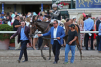 HALLANDALE BEACH, FL - March 31:  #2 Coach Rocks with jockey Luis Saez on board, makes her way to the winners' circle.  Scenes from Florida Derby Day at Gulfstream Park on March 31, 2018 in Hallandale Beach, Florida. (Photo by Liz Lamont/Eclipse Sportswire/Getty Images)