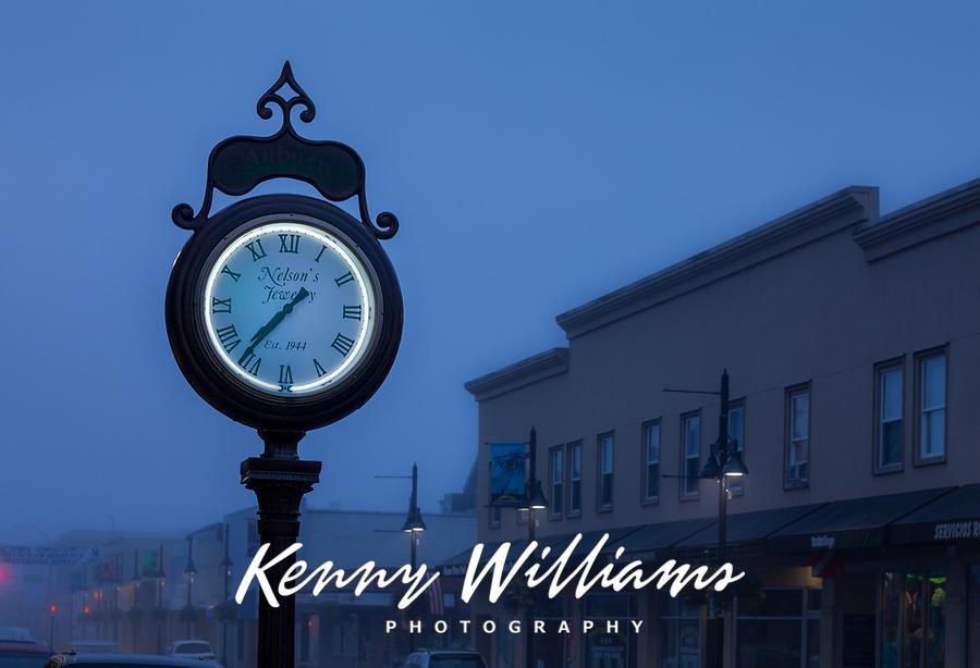 Large antique clock at dusk in Foggy Weather, Auburn, Washington State, USA.