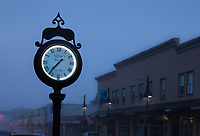 Large antique clock at dusk in Foggy Weather, Auburn, Washington State, USA.