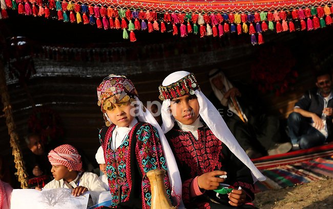 Palestinain bedouins girls wear traditional dress during a rally marking the 41st anniversary of Land Day, in Deir el-Balah, Central Gaza Strip, on March 31, 2017.  Land Day marks the killing of six Arab Israelis during 1976 demonstrations against Israeli confiscations of Arab land. Photo by Ashraf Amra