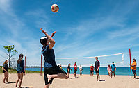 Great Lakes Secondary School senior physical education students spent on of their last classes at Canatara Park beach playing volleyball. A group of 17 students under the direction of teacher Peter Kaija helped usher in the summer holidays. Nick Barraclough serving