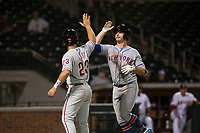 Scottsdale Scorpions first baseman Peter Alonso (20), of the New York Mets organization, is congratulated by Austin Listi (23) after hitting a home run during an Arizona Fall League game against the Mesa Solar Sox at Sloan Park on October 10, 2018 in Mesa, Arizona. Scottsdale defeated Mesa 10-3. (Zachary Lucy/Four Seam Images)