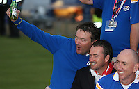 Graeme McDowell (EUR) and caddie Ken Comboy with a beer at the final photocell as winners of the 2014 Ryder Cup from Gleneagles, Perthshire, Scotland. Picture:  David Lloyd / www.golffile.ie