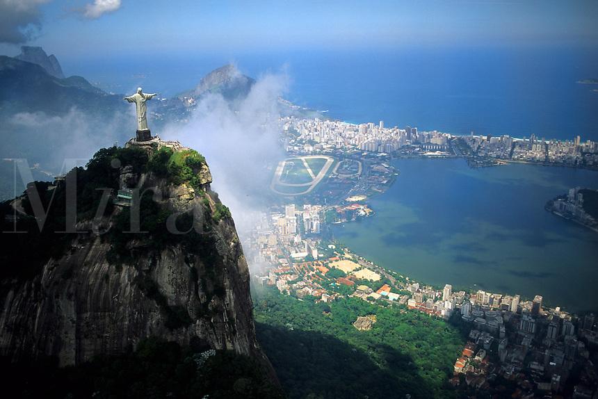Corcovado Christ Statue on mountain peak in Rio De janeiro above Copacabana Beach Brazil