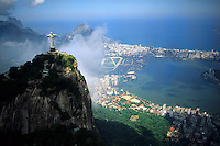 Corcovado Christ Statue on mountain peak in Rio De janeiro above Copacabana Beach Brazil