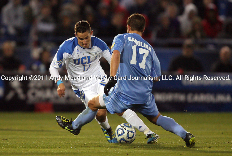09 December 2011: UCLA's Chandler Hoffman (left) and North Carolina's Ben Speas (right). The University of California Los Angeles Bruins played the University of North Carolina Tar Heels to a 2-2 tie after overtime, with the Tar Heels advancing with a 3-1 win in the penalty kick shootout at Regions Park in Hoover, Alabama in an NCAA Division I Men's Soccer College Cup semifinal game.