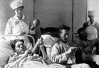 Bed-ridden wounded, knitting.  Walter Reed Hospital, Washington, D.C.  Ca. 1918-19. Harris & Ewing.  (War Dept.)<br /> Exact Date Shot Unknown<br /> NARA FILE #:  165-WW-265B-17<br /> WAR & CONFLICT BOOK #:  674