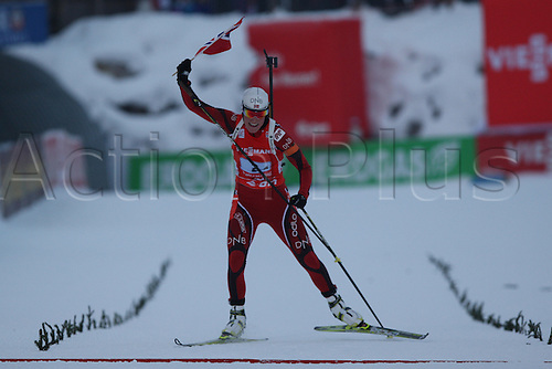 09.12.2012.  Hochfilzen, Austria. Tora BERGER (NOR) celebrates with a national flag at the finish of the E.On IBU Biathlon World Cup - Relay races - Stage 2 in Austria