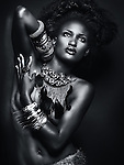 Dramatic beauty portrait of a young beautiful african american woman wearing jewelry, high contrast black and white photo.