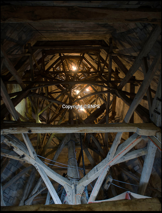 BNPS.co.uk (01202 558833)<br /> Pic: PhilYeomans/BNPS<br /> <br /> Before it was hard to make out the wooden framework of the spire.<br /> <br /> Let there be light...generous volunteer reveals medieval marvel for the first time in its history.<br /> <br /> A dedicated cathedral tour guide has dipped in to his own pocket to pay for the installation of lights to illuminate the inside of Britain's tallest spire for the first ever time.<br /> <br /> Robert Stiby, 79, has been a lifelong admirer of Salisbury Cathedral in Wiltshire, but after spending the last eight years guiding visitors up the 330 steps to the spire he became frustrated by the lack of light to reveal its true glory.<br /> <br /> The full extent of its amazing medieval feat of engineering could barely be seen in the gloom, until Robert splashed out £5000 of his own money to install 24 LED lights to reveal the oak structure that holds up the final 180ft of its needle like spire.