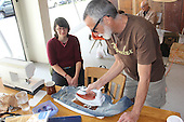 People spent Saturday afternoon learning to stitch, patch and sew old garments to make them new again.<br /> <br /> Instructor, Elanor Ray showed Doug Shaeffer how to put patches on an old pair of jeans.