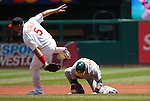 June 20, 2010       St. Louis Cardinals first baseman Albert Pujols (5) leaps over the top of Oakland Athletics first baseman Daric Barton (10) and tags him out in the process as Barton was caught in a rundown between first and second bases in the first inning.  The St. Louis Cardinals lost 3-2 to the Oakland Athletics in the final game of a three-game homestand at Busch Stadium in downtown St. Louis, MO on Sunday June 20, 2010.