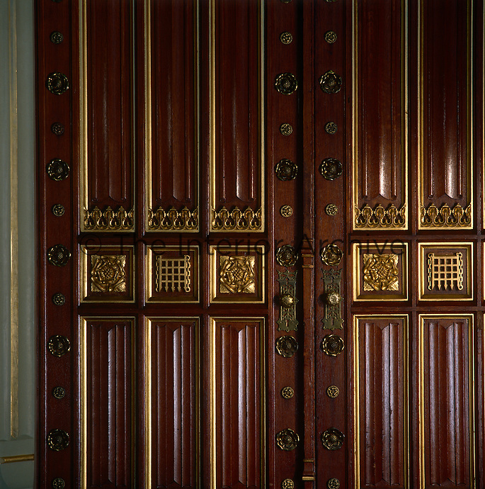 Detail of the carved and gilded Tudor roses and grilles on the double doors to the Robing Room