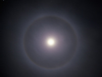 A 22 degree halo encircles the moon as a thin layer of ice-crystal clouds (cirrostratus) covers the sky over central Oklahoma.